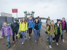 Students walking from the ferry onto Islesboro.