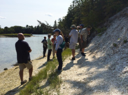 Workshop participants inspect a shell midden in the Damariscotta area