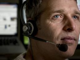close up of man wearing headset