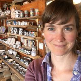 Islesford potter Kaitlyn Duggan taking selfie in front of her work