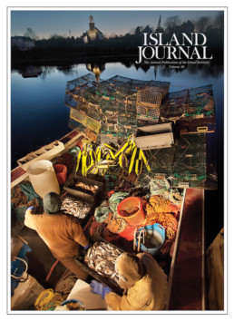 Island Journal magazine cover featuring fishing boat at dawn shot from above