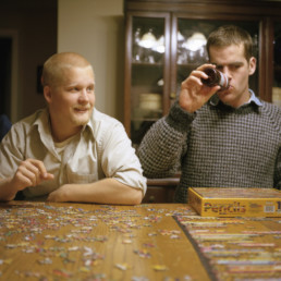 two men doing a puzzle