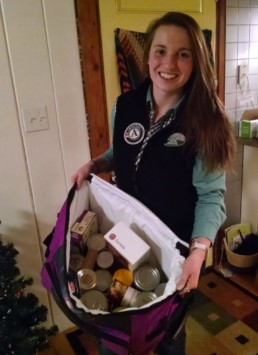 woman with bag of food drive donations