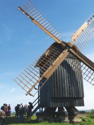 people standing under a dutch windmill