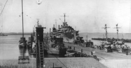 black and white photo of docked world war II vessels