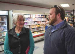 two people talking in a grocery store