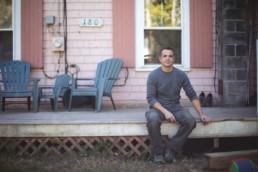 man sitting on a porch