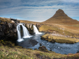 waterfalls and pointy mountain in Iceland