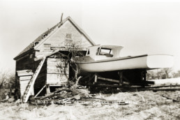 old photo of boat on land