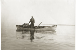 old photo of a man in a canoe