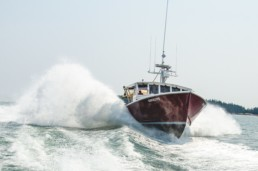 red lobster boat moving through water