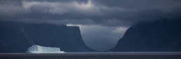 iceburg and mountains in clouds