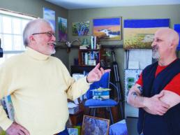 two men in an artists studio