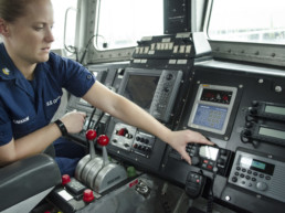 US coast guard woman working controls