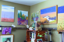 corner of a room with paintings on the walls