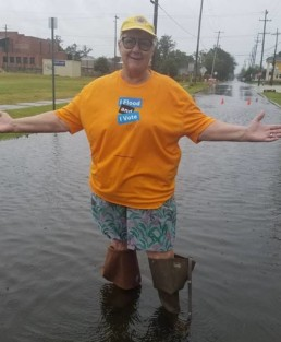 woman standing ankle-deep in floodwater