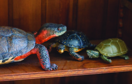 three small turtle sculptures