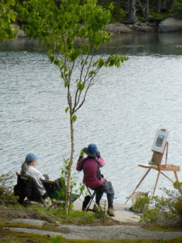 two women. plein air painting