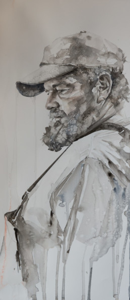 watercolor painting of side profile of bearded man wearing hat