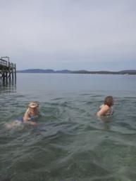 women swimming in ocean