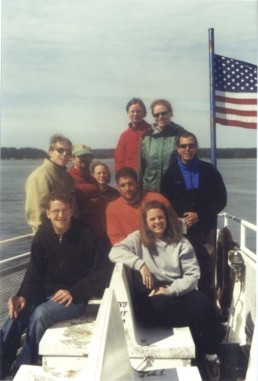 group of people on a boat with an american flag