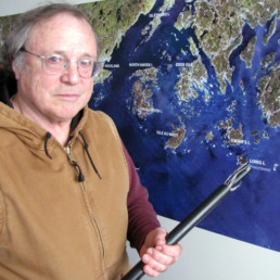 man standing in front of map of maine islands
