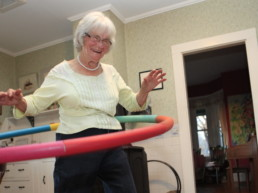 smiling old woman hola hooping