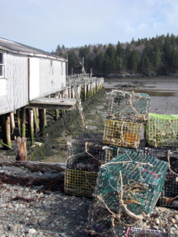 lobster traps stacked by a dock