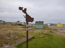 metal sculpture in shape of island