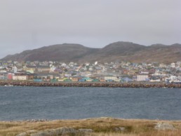 colorful buildings on island on cloudy day