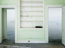 room with two open doors, ocean landscape fading into doorways