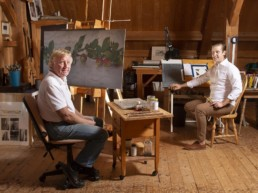 old man and son in artist studio