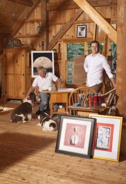 two men in wooden artist studio
